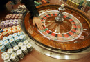 "A staff member demonstrates the roulette wheel for the media at the new casino ""Grand Lisboa Casino"" in Macau, Sunday, Feb. 11, 2007. Billionaire gambling king Stanley Ho celebrated the long-awaited opening Sunday of his Grand Lisboa casino _ a gleaming gold complex that is Ho"